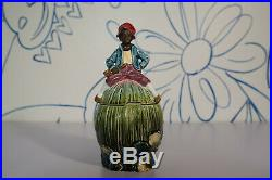 Black Americana Majolica Tobacco Jar, boy, pipe, green/blue/